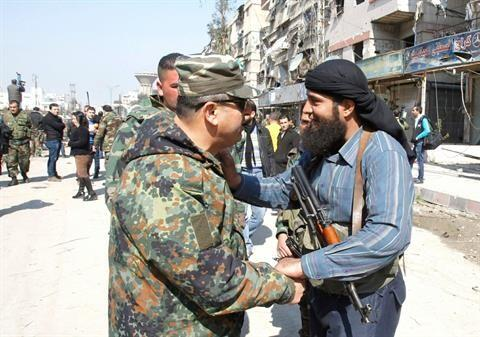 NDF member (left) being embraced by a rebel fighter (right) in Babila, Damascus, after a ceasefire (February 2014)