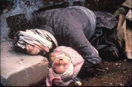 The most infamous photograph from the chemical weapons attack on Halabja, a woman who has tried to shield her baby from the poison gas