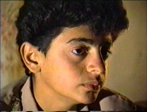 Taimor Abdallah Rokhzai in Nov. 1991 being interviewed by Kanan Makiya, showing in the 1992 TV documentary 'The Road to Hell' (shown on PBS in 1993 as 'Saddam's Killing Fields'). The only survivor of the Anfal mass-shootings, he was 12 in 1988.