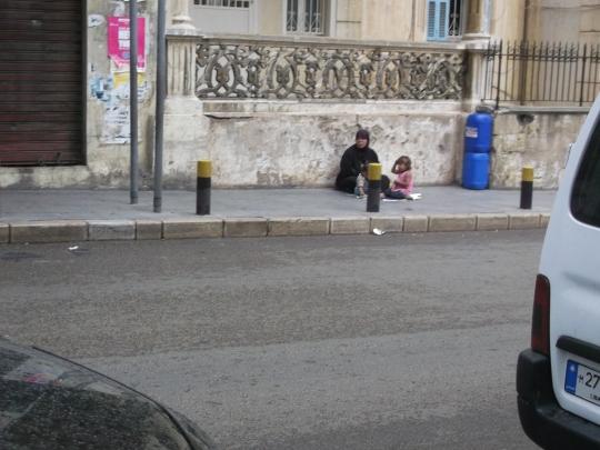 Syrian refugee with her children
