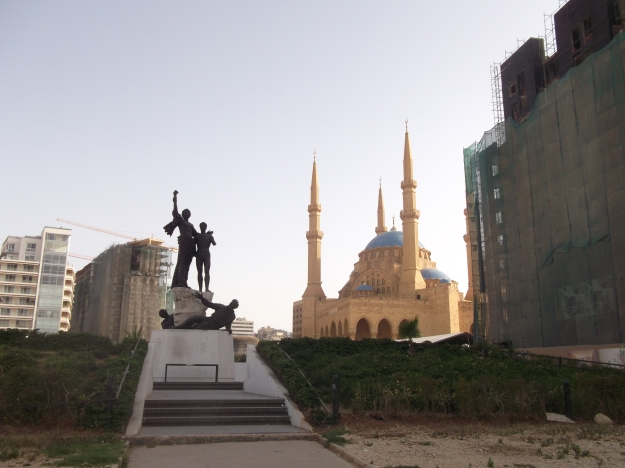 Statue in the centre of Martyrs' Square, Beirut, and the Mohammad al-Amin Mosque
