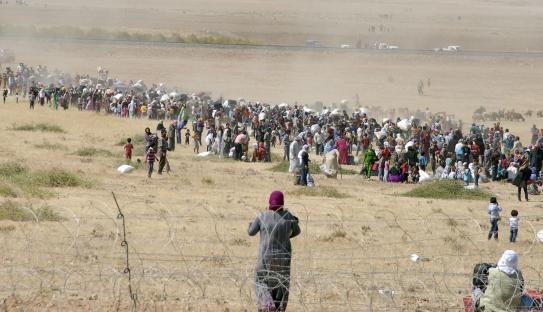 Kurds fleeing Kobani