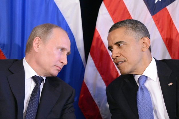 US President Barack Obama (R) listens to Russian President Vladimir Putin after their bilateral meeting in Los Cabos, Mexico on June 18, 2012 on the sidelines of the G20 summit. Obama and President Vladimir Putin met Monday, for the first time since the Russian leader's return to the presidency, for talks overshadowed by a row over Syria. The closely watched meeting opened half-an-hour late on the sidelines of the G20 summit of developed and developing nations, as the US leader sought to preserve his