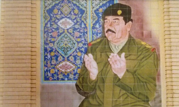 Mural of Saddam Hussein at prayer on Al-Kadhimiya Mosque
