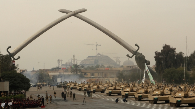 Iraqi army MIA1 Abrams tanks march under the victory Arch landmark during a parade to mark the 91st Army Day in Baghdad on January 6, 2012, weeks after US troops completed their pullout. The Armed Forces Day display by the fledgling 280,000-strong security force completely reformed after the US-led invasion of 2003. AFP PHOTO/ALI AL-SAADI (Photo credit should read ALI AL-SAADI/AFP/Getty Images)