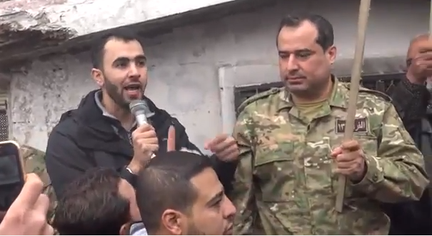 Journalist Hadi al-Abdallah and Division 13 commander Ahmad as-Saoud at an anti-Assad protest in Maarat an-Numan, March 4, 2016.