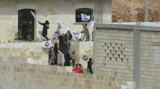 People in Maarat an-Numan protest against Jabhat an-Nusra from within a Division 13 base (March 14, 2016)