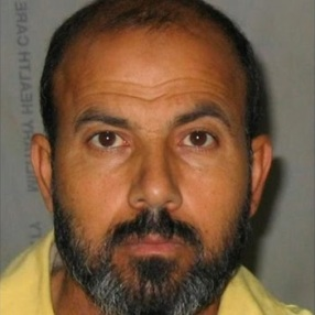 Picture of Adnan al-Suwaydawi after he was arrested in 2007.